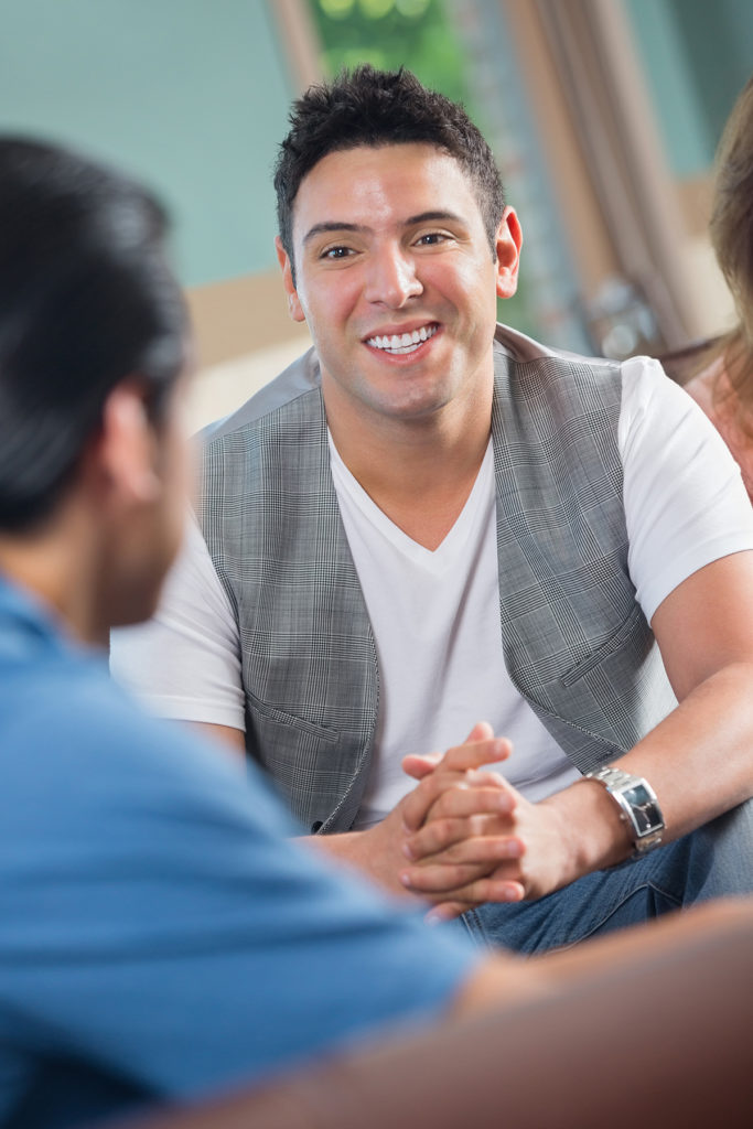 A student smiling talking to a counselor.