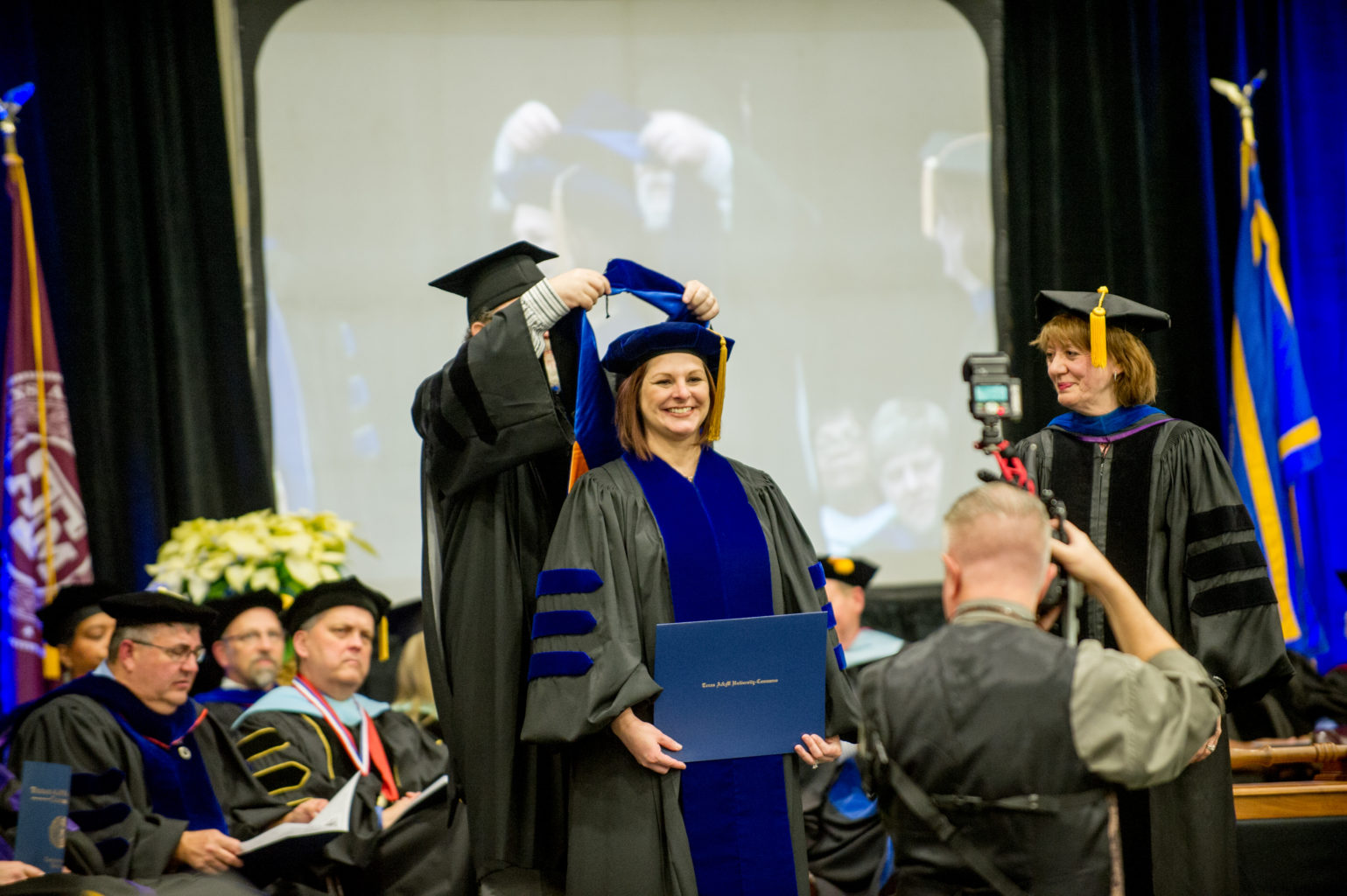 Woman receiving honors during a graduation ceremony.