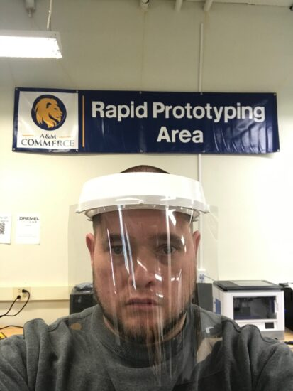 Dr.Moler wearing one of the face shields that the department of Engineering and Technology (Rapid Prototyping Area) is producing for Area Medical Center.