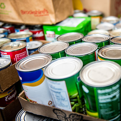 Cans of food delivered to a food drive.