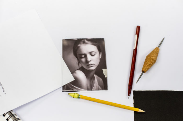 Photography portrait on table with art supplies.