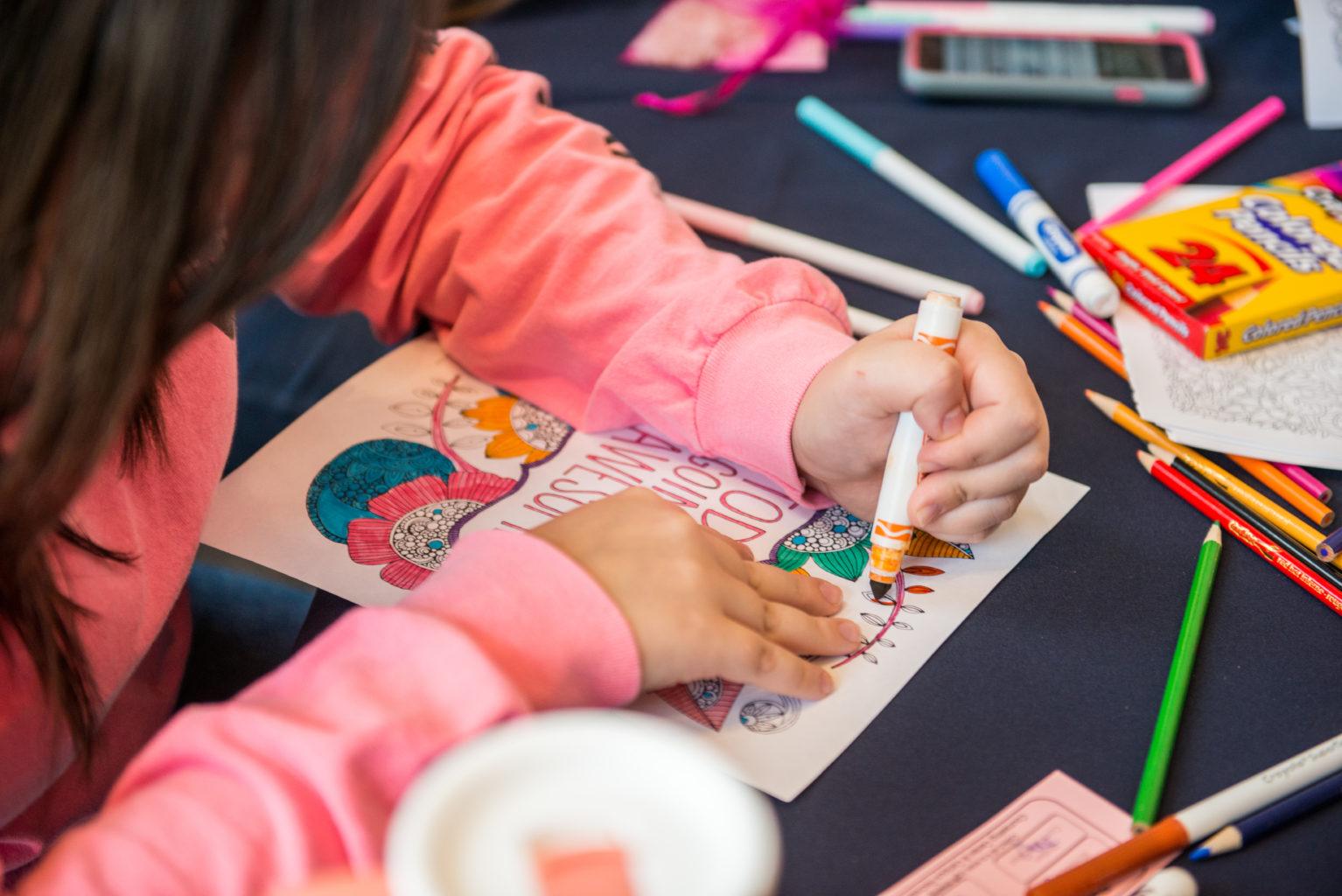 Unrecognizable woman coloring.