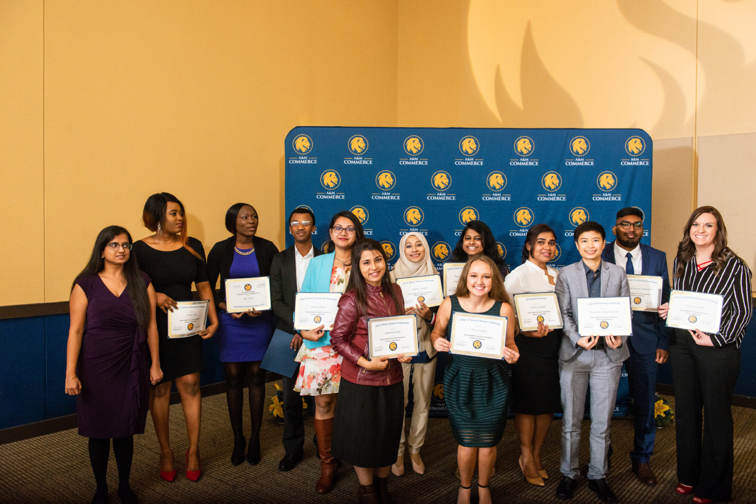 Group photo of students from TAMUC College of Business holding their certificates.