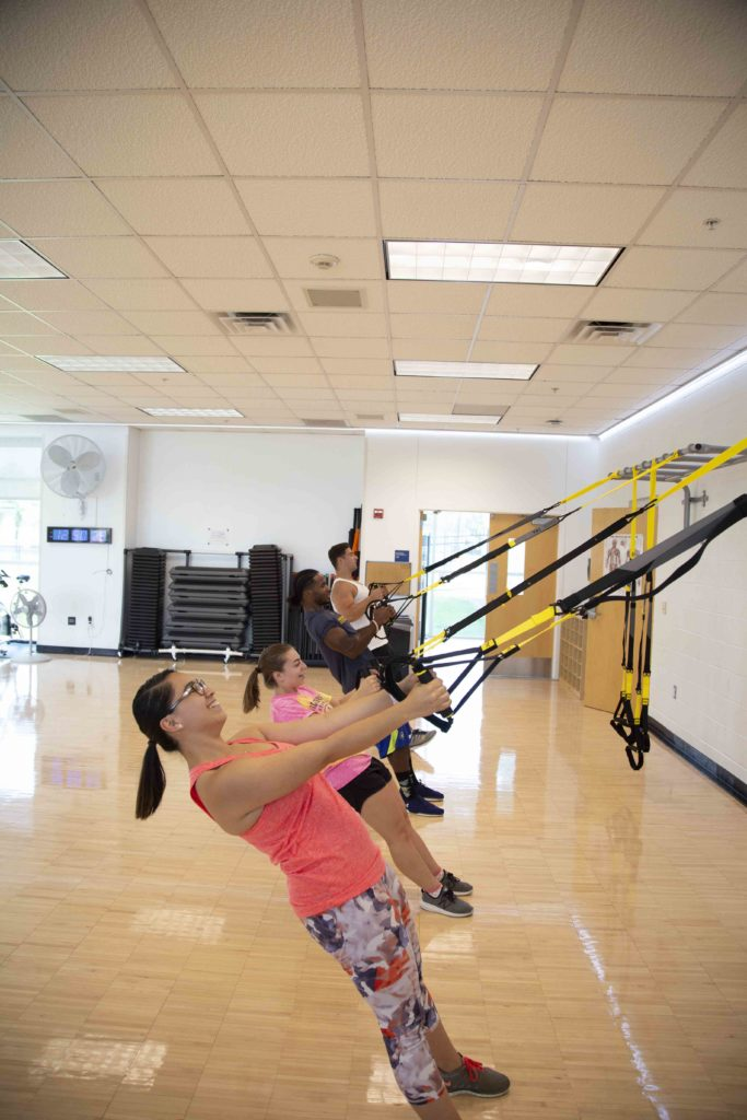 Students exercising in the activity room at Morris Recreation Center.