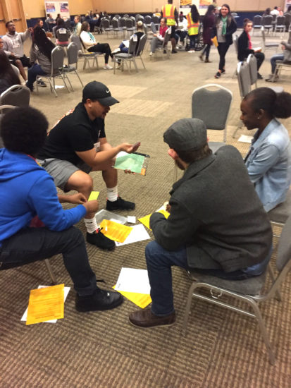 Students at Texas A&M University-Commerce participate in a poverty simulation.