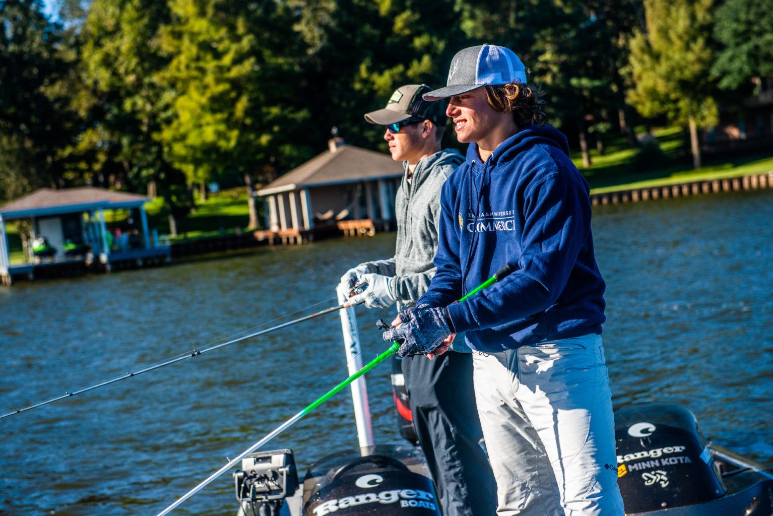 Two fishing club members fishing.
