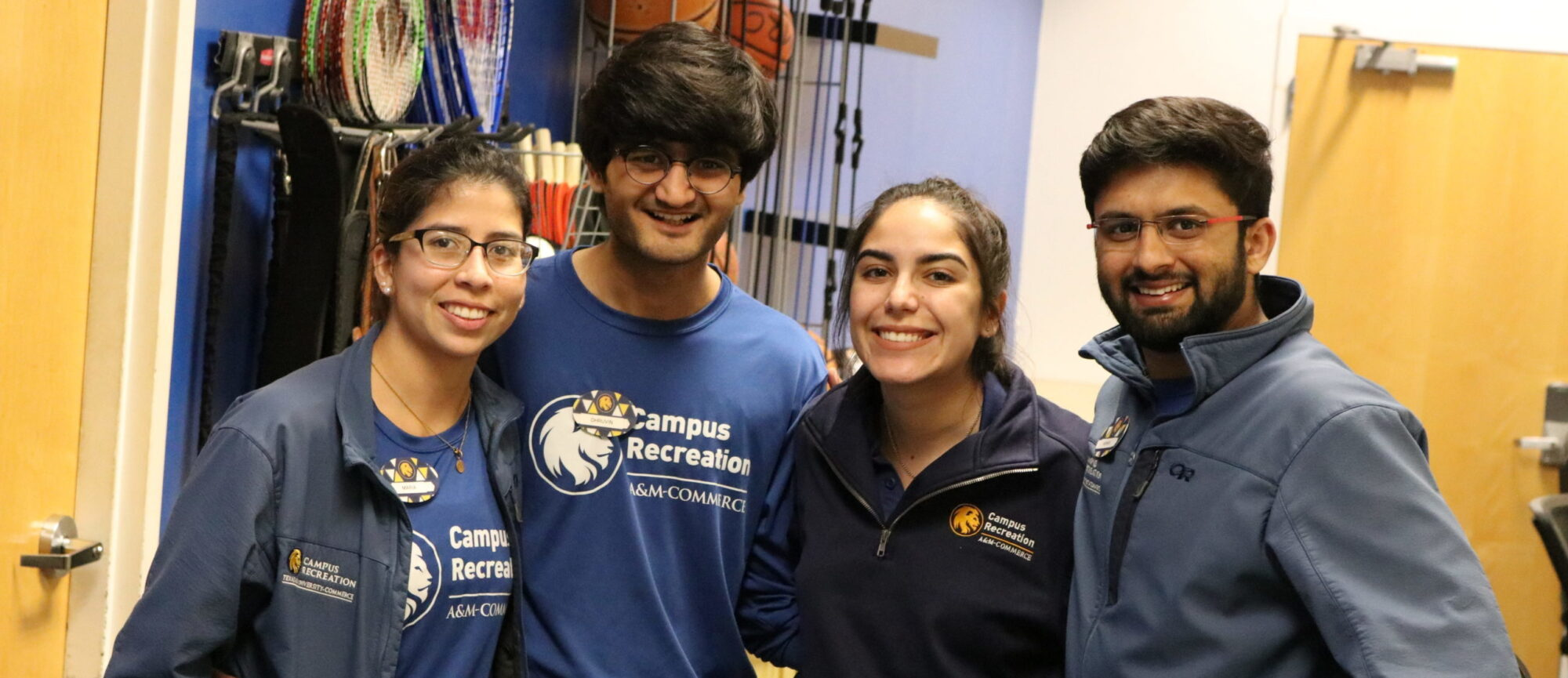 Four student employees smiling at the camera.