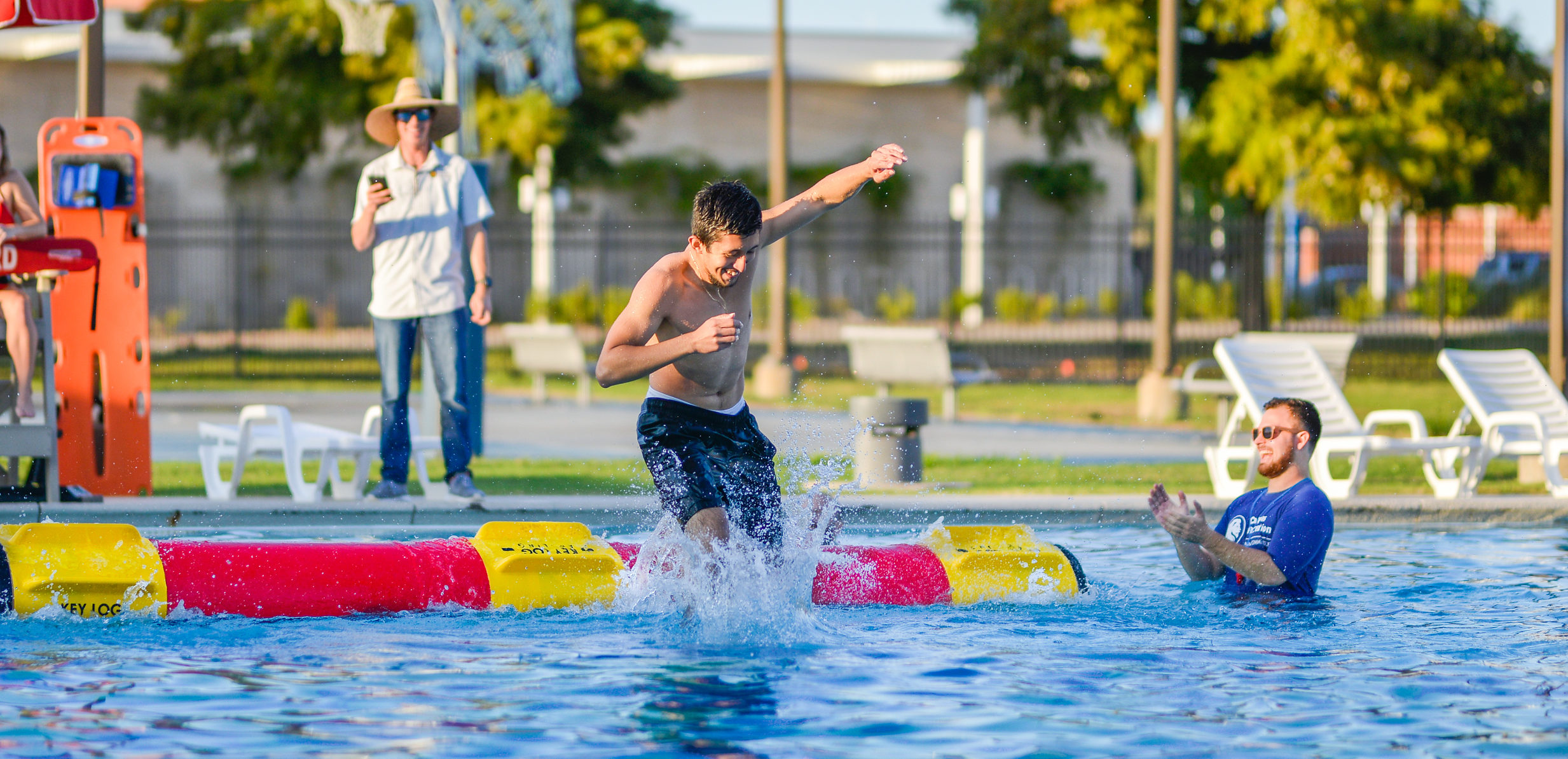A student during a log rolling competition at the Campus Recreation pool.