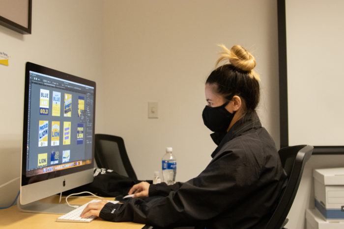 Campus Rec employee working on a computer.