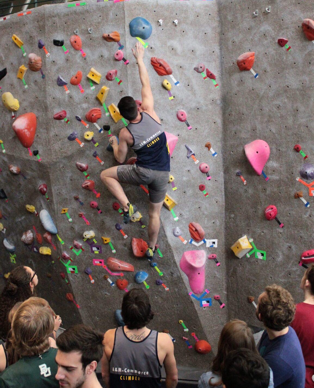 A member of the Climbing Club climbing indoor wall.
