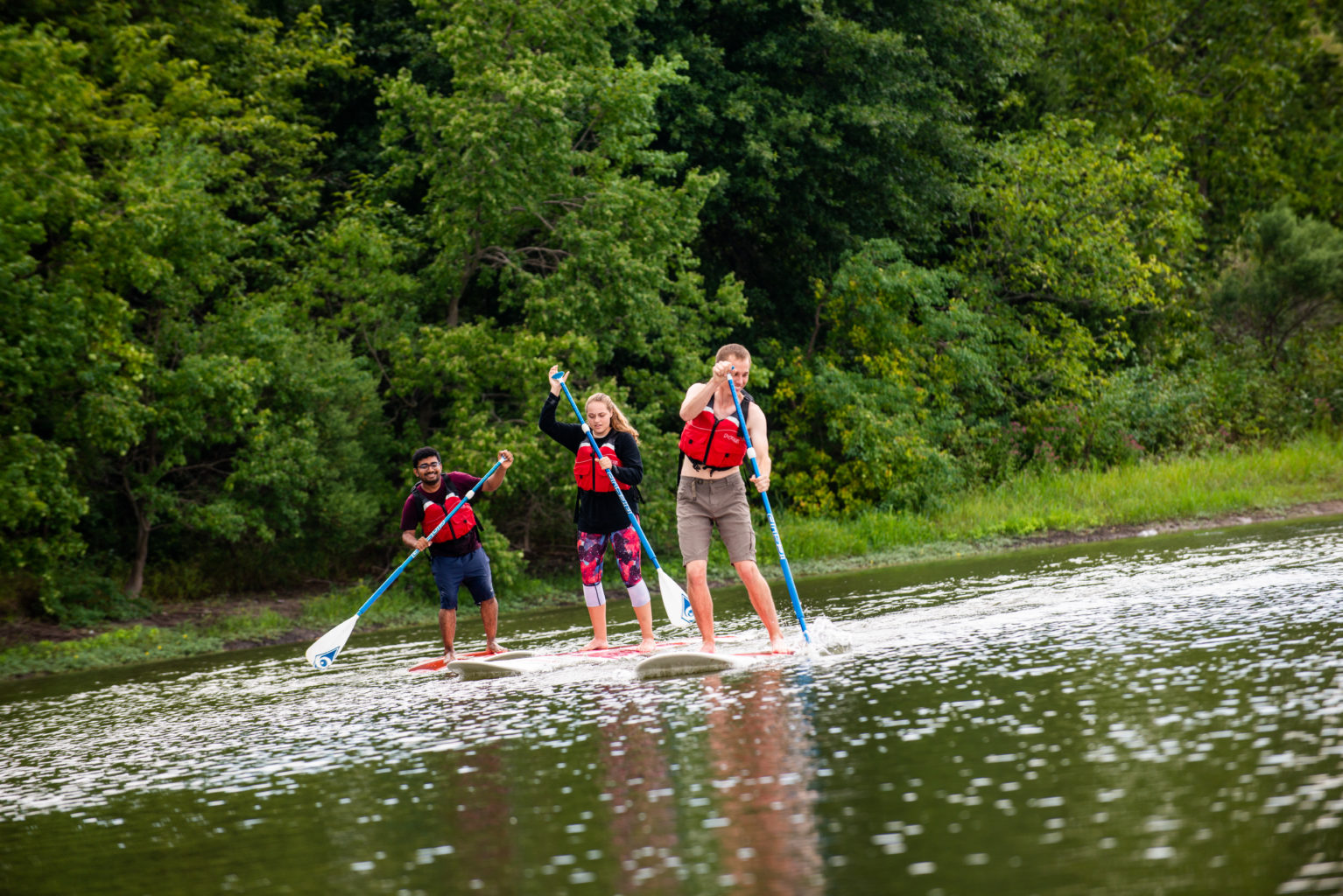 Students paddle boarding