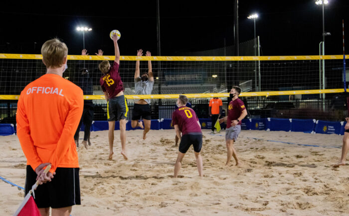 A Campus Recreation referee during a sand volleyball game.