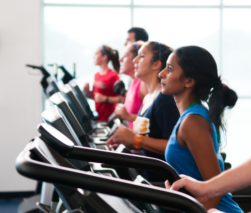 People exercising on treadmills at the Morris Recreation Center.