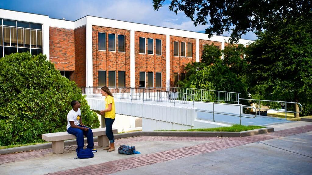 students interacting background 'McDowell Administration Building'.