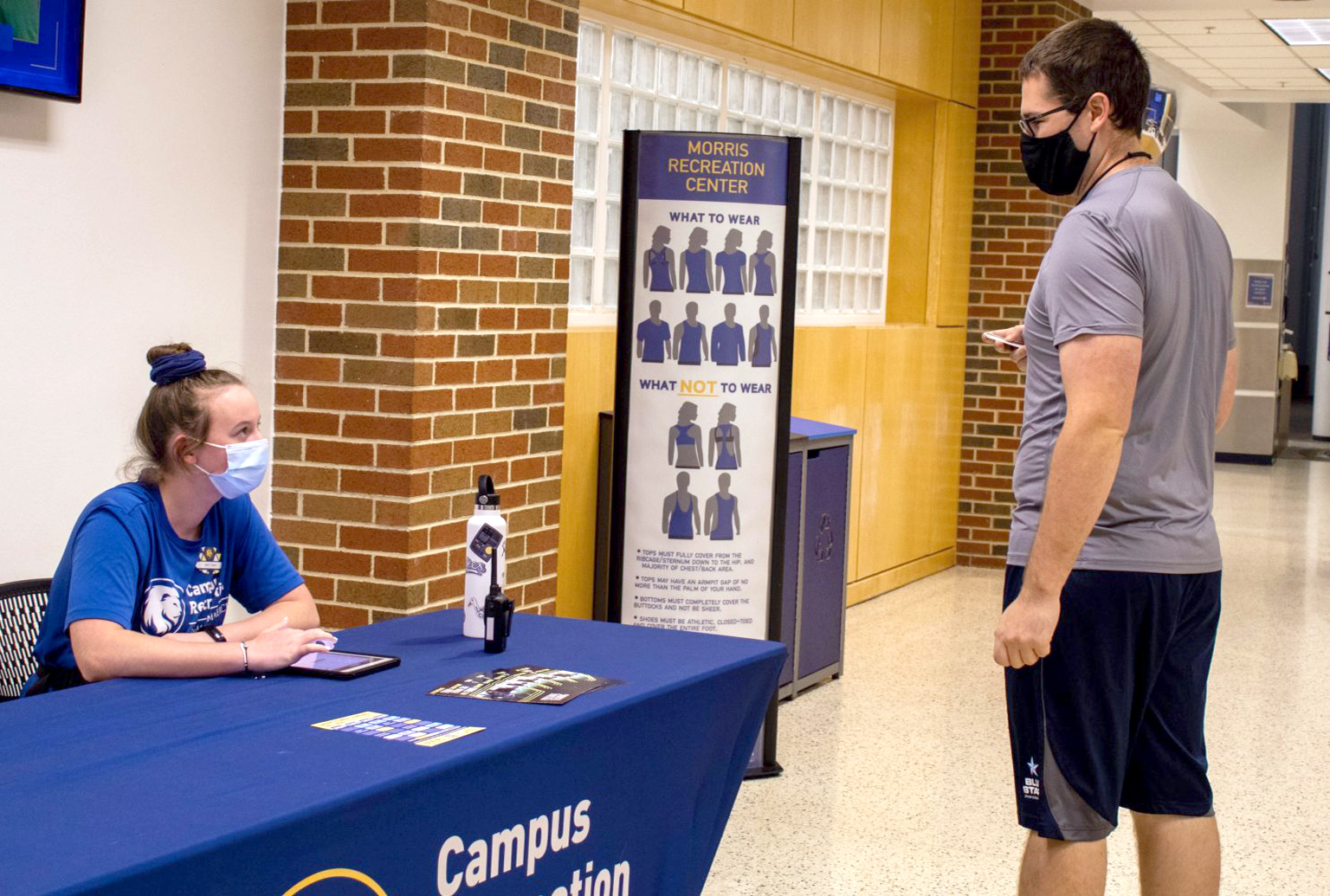 Campus Recreation worker checking in a member.