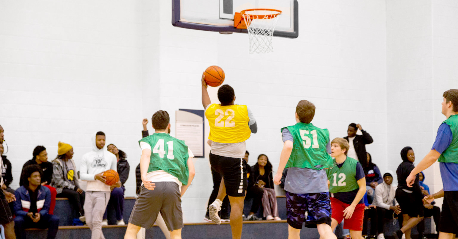 Students playing a basketball game at the Morris Recreation Center.