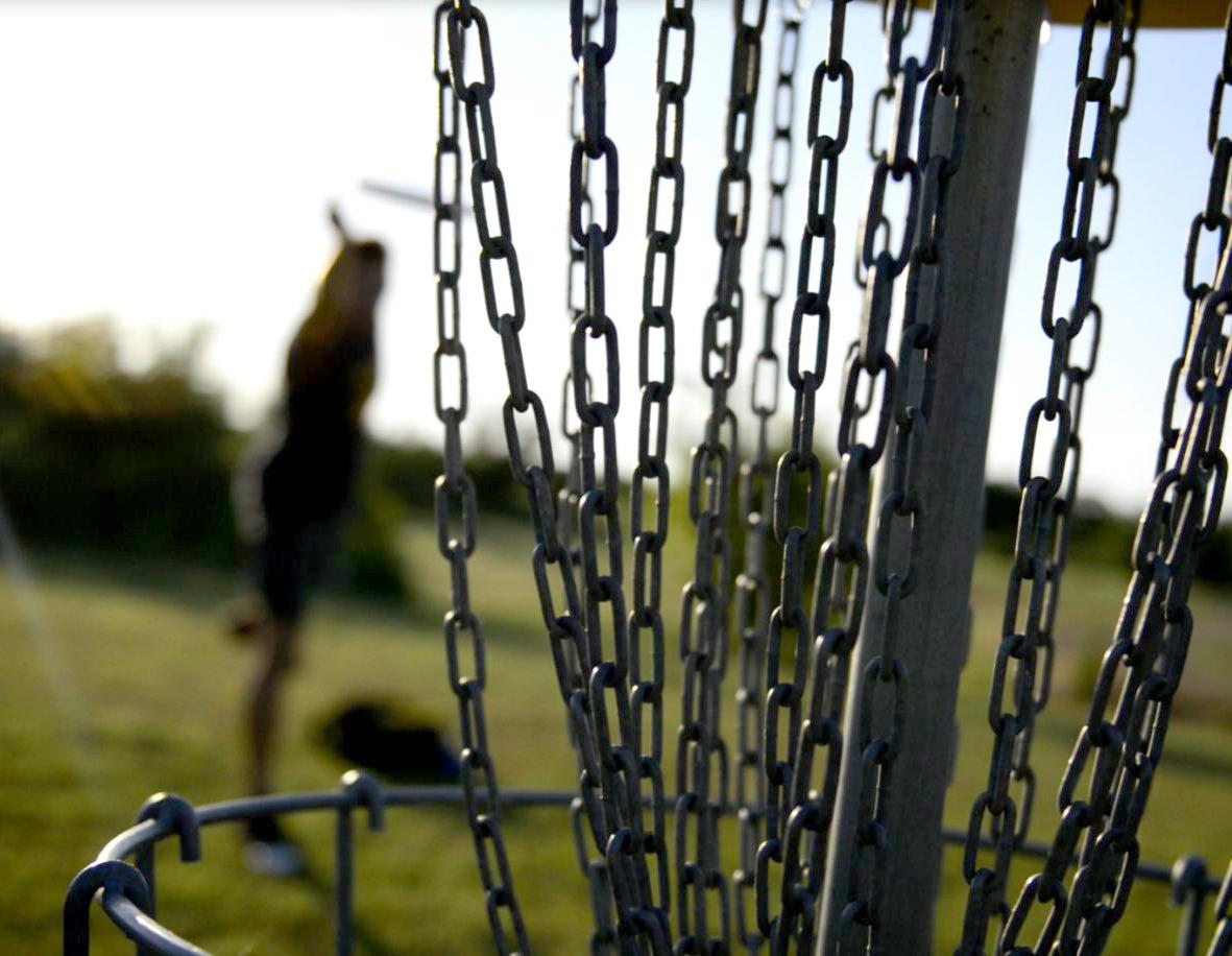Close up of a disc golf metal net.