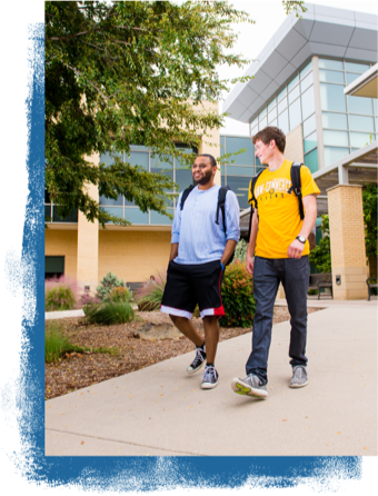 Two student walking on campus.