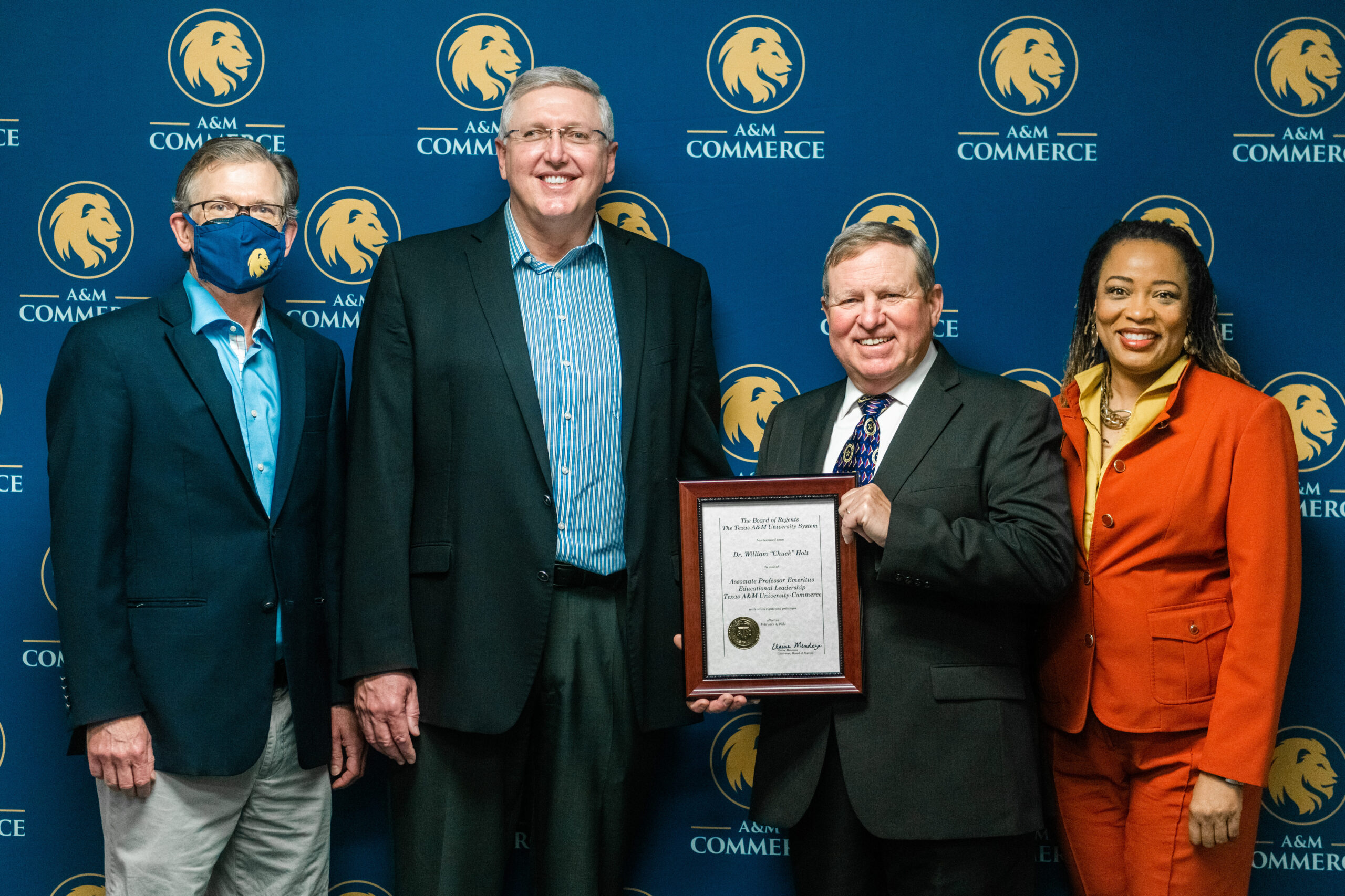 Dr. Chuck Holt receiving Emeritus certificate