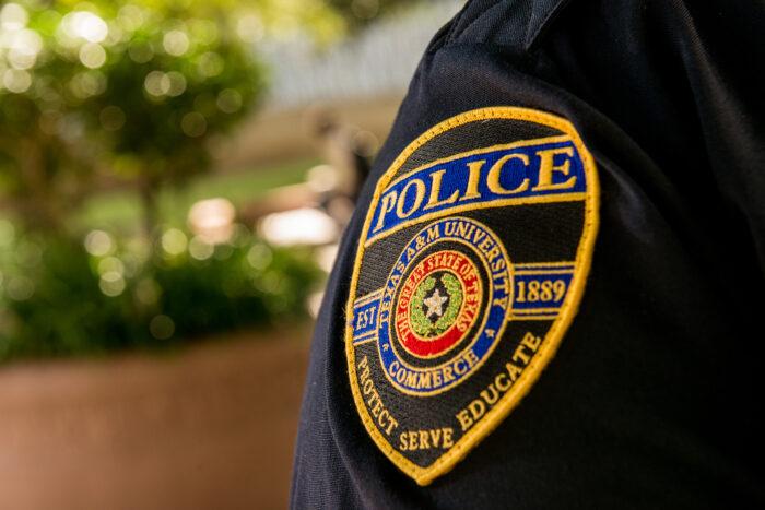 University police badge on officer uniform.