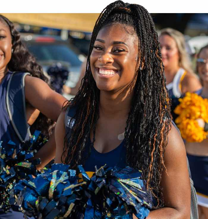 TAMUC Cheerleader smiling at the camera.
