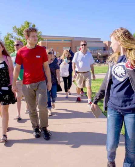 Potential students walking on a campus tour.